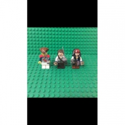 Lego Pirates Of the Carribean minifigures Jack Sparrow, Admiral Norrington, and an Imperial Soldier